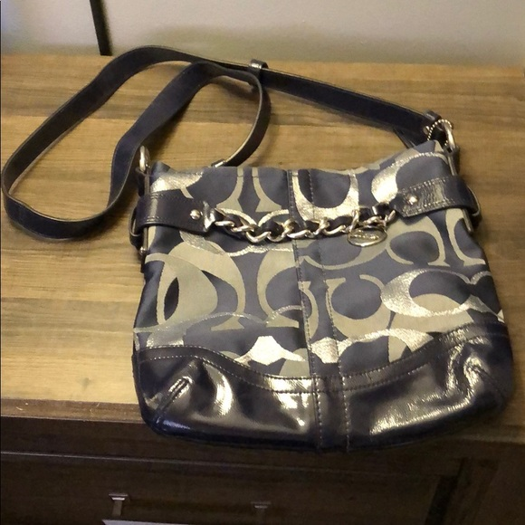 c7307b99cda5 Coach crossbody navy and silver purse. Coach. M 5be8d333aa877084a711a1ed.  M 5be8d3368ad2f997fca6e2cc. M 5be8d33c2beb79ca82699d79.  M 5be8d34bd6dc52e09356449f